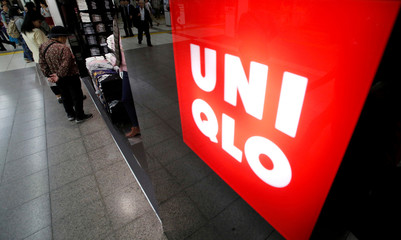 File photo of shoppers look at items at Fast Retailing's Uniqlo casual clothing store in Tokyo