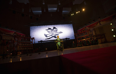 """A performer plays the traditional musical instrument """"Pipa"""" at the 5th Beijing Traditional Music Festival"""