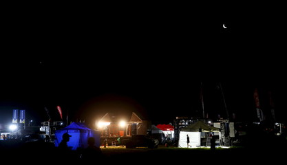 The moon is seen over the bivouac of the Dakar Rally 2016 in La Rioja