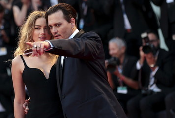 "Actor Depp and his wife Heard attend the red carpet event for the movie ""Black Mass"" at the 72nd Venice Film Festival"