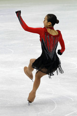 Japan's Asada stumbles as she lands after jump during her routine in women's free skating figure skating event at Vancouver 2010 Winter Olympics