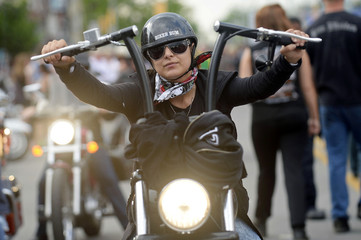 An unidentified woman rides during the Friday the 13th biker rally in Port Dover