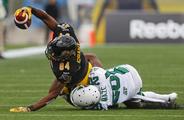 Hamilton Tiger-Cats' Grant catches a pass against Saskatchewan Roughriders' Maze during the second half of their CFL football game in Hamilton
