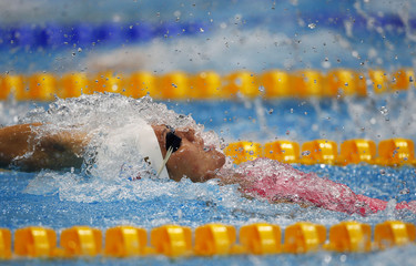 Russia's Anastasia Zueva swims in heat 5 during the women's 100m backstroke heats at the London 2012 Olympic Games at the Aquatics Centre