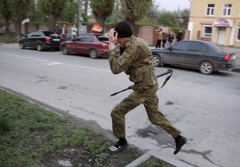 Armed pro-Russian activist runs in Luhansk