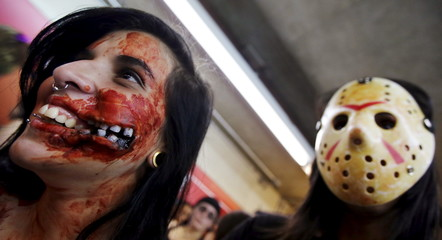 "Revellers with their bodies and faces painted attend the ""Zombie Walk"" parade in Sao Paulo, Brazil"