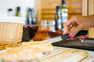 Hand slicing a bread