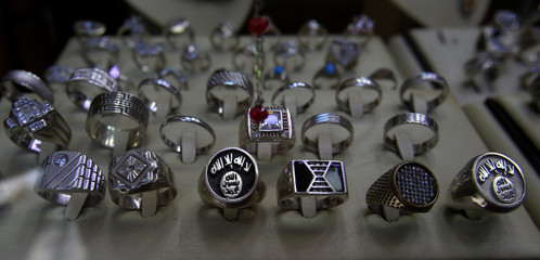 Silver rings with the Islamic State logo are displayed for sale in Tripoli city