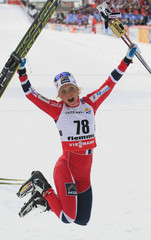 Johaug of Norway celebrates her gold medal in the Cross Country women's 10km Individual Free Technique competition at the Nordic Ski World Championships in the northern mountain resort of Tesero in Val di Fiemme