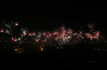 Shi'ite Houthis release fireworks as they celebrate Sunday's signing of a power-sharing deal in Sanaa