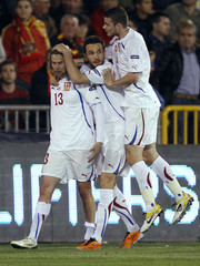 Czech Republic's Plasil is congratulated by teammates after scoring against Spain during Euro 2012 qualifying Group I soccer match at the Los Carmenes stadium in Granada