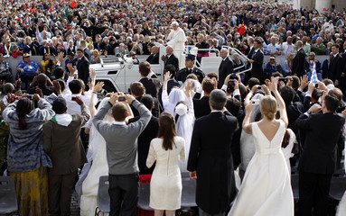 Pope Benedict XVI arrives to lead his Wednesday general audience in Saint Peter's square at the Vatican