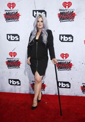 Television personality Kelly Osbourne poses at the 2016 iHeartRadio Music Awards in Inglewood