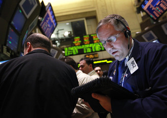 Trader Warren Meyers works on the floor of the New York Stock Exchange