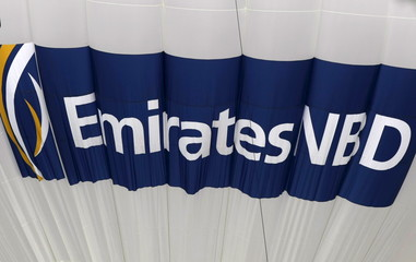 File photo of the logo for Emirates NBD bank on a deflating hot air balloon over the Emirates Golf Course in Dubai