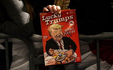 U.S. Republican presidential candidate Donald Trump's image is seen on a mock cereal box similar to Lucky Charms cereal after Trump autographed it at a campaign town hall in Davenport