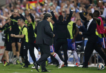 Barcelona's coach Gerardo Martino walks after their Spanish First Division soccer match against Granada at Nuevo Los Carmenes stadium in Granada