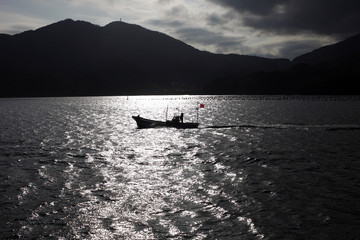 A fishing boat is seen at an area damaged by March 11, 2011 earthquake and tsunami in Ofunato