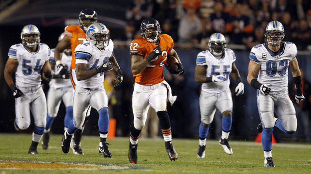 Bears running back Forte is chased by the Detroit Lions in the second half of their NFL football game in Chicago