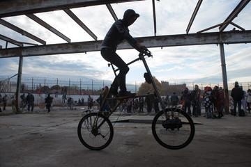 "A man rides a tall bike during ""Bike Kill 12"" in the Brooklyn borough of New York City"