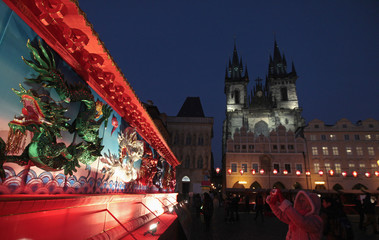 A woman takes a picture of an installation during Chinese Lunar New Year celebrations in Prague