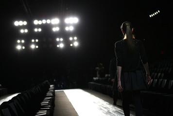 A model has a rehearsal before the Max Azria Fall 2010 collection during New York Fashion Week