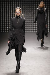 A model presents a creation by designer Gareth Pugh as part of his Fall-Winter 2011/2012 women's ready-to-wear fashion collection during Paris Fashion Week