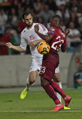 Portugal's Ivan Cavaleiro fights for the ball with Albania's Mergim Mavraj during their Euro 2016 qualifying soccer match at the Aveiro city stadium in Aveiro