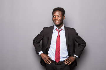 Portrait of a successful confident african businessman professional in a smart formal suit isolated