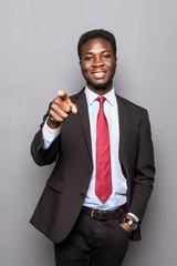 Charming handsome young black business man pointing his hand up to show present sell product isolated