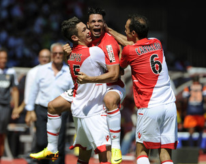 Monaco's Emmanuel Riviere celebrates his goal with teammates Ocampos and Carvalho during their French Ligue1 soccer match against Montpellier in Monaco