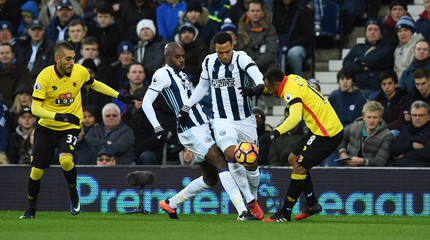 Watford's Roberto Pereyra (L) and Juan Camilo Zuniga (R) in action with West Bromwich Albion's Allan Nyom (2nd L) and Matt Phillips