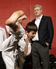 Venczel practices a karate kick in front of Harper during a campaign event at a gym in Ottawa
