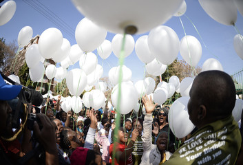 Children release 95 white balloons to mark the upcoming 95th birthday on July 18 of ailing former South African President Nelson Mandela outside the Medi-Clinic Heart Hospital where he is being treated in Pretoria