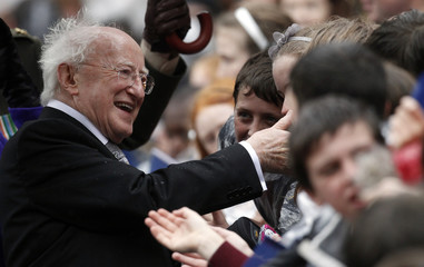 Irish President Michael D Higgins meets people in the crowd after his Inauguration ceremony in Dublin Castle, Dublin