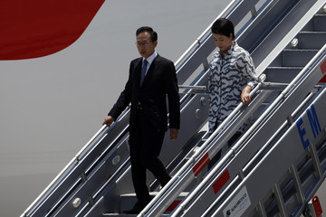South Korea's President Lee Myung-bak and his wife Kim Yoon-ok arrive at the International Airport of Los Cabos