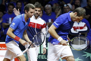 France's Davis Cup team captain Arnaud Clement encourages his players Benneteau and Gasquet during their Davis Cup final doubles tennis match against Switzerland's Federer and Wawrinka at the Pierre-Mauroy stadium in Villeneuve d'Ascq