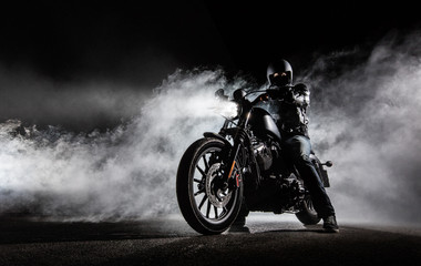High power motorcycle chopper with man rider at night Wall mural