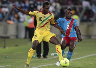Mali's Maiga plays the ball against Democratic Republic of Congo's Issama during their African Nations Cup Group B soccer match at the Moses Mabhida stadium in Durban