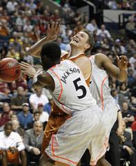 Cincinnati's Justin Jackson blocks Texas' Clint Chapman's shot during the second half of their men's NCAA basketball game in Nashville, Tennessee