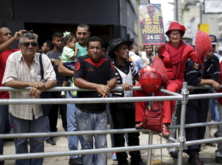 People atend a military parade in honor of Camejo, Venezuela's Independence hero known as Negro Primero, in Caracas
