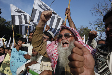 A supporter of the Islamic organization Jamaat-ud-Dawa shouts anti-American slogans while taking part in a demonstration against NATO cross-border attack in Lahore