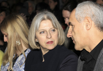 Britain's Home Secretary Theresa May attends the Osman 2012 Autumn/Winter collection during London Fashion Week in London