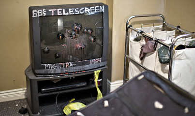 A TV hit several times with paintballs sits in the corner of the apartment rented by suspects Nuttall and Korody in Surrey