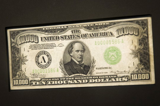 """A $10,000 bill on loan from the collection of Drs. Joanne and Edward Dauer is displayed in the """"America in Circulation"""" exhibit at the Museum of American Finance in New York"""