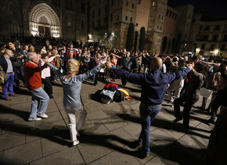 People take part in a Sardana dance, a typical Catalan dance, near the Cathedral in Barcelona