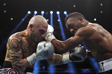 Miguel Cotto and Austin Trout exchange blows during their Super Welterweight World Championship fight in New York