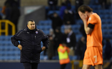 Braintree Town manager Hakan Hayrettin looks dejected at full time