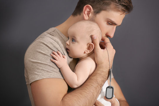 Military father holding his newborn baby