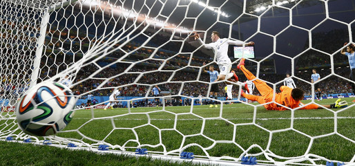 England's Rooney scores goal past Uruguay's Muslera during their 2014 World Cup Group D soccer match at the Corinthians arena in Sao Paulo
